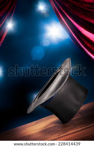 magic hat and magic wand on a wooden floor - stock photo