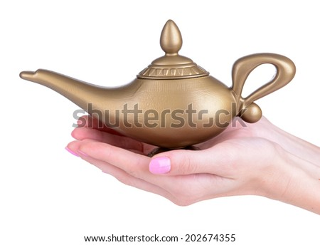 Magic lamp in female hands isolated on white - stock photo