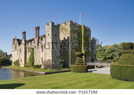 Magic medieval Hever Castle viewed over the water ditch on a sunny day - stock photo