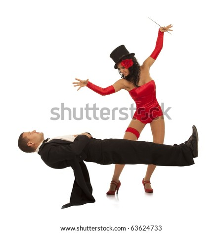 Magic moment - woman performing magically levitating her assistant on white background - stock photo