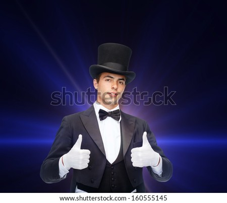 magic, performance, circus, show concept - magician in top hat showing thumbs up