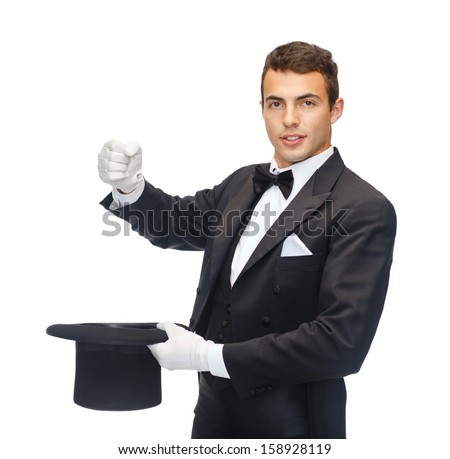 magic, performance, circus, show concept - magician in top hat showing trick with imaginary rabbit - stock photo