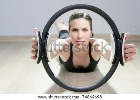 magic pilates ring woman aerobics sport gym exercises on wooden floor - stock photo