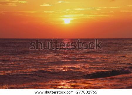 Magic purple sunset on the Black Sea. Special tone correction. - stock photo