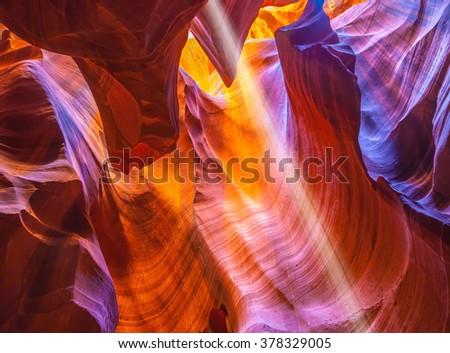 Magic ray of sunshine in the colored fantastic slot canyon Antelope.  The Navajo reservation, Arizona, USA - stock photo
