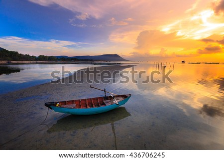 magic sky and cloud amazing reflection at dawn with a fisherman boat -  reflection natural image - stock photo