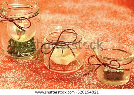 Magic winter decoration - jars with winter decoration inside (cake, candle, and Santa Claus)