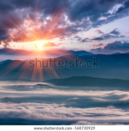 Frosty Morning Mountains Colorful Sunrise Winter Stock Photo - This man hikes up the transylvanian mountains every morning to photograph sunrise