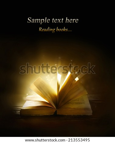 Magical book on bright background - stock photo