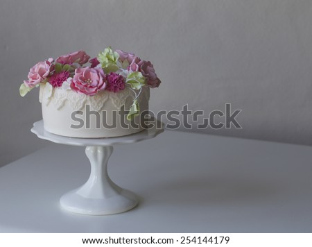 Magical cake made with delectable and beautifully hand made flowers.