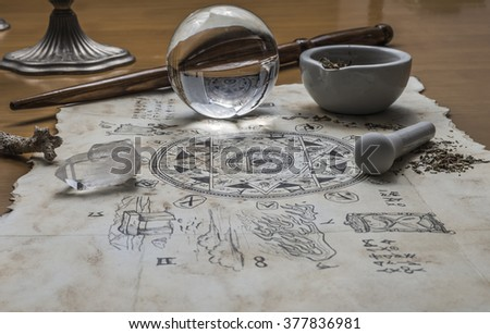 Magical elements are gathered together ready to cast a magic spell - stock photo