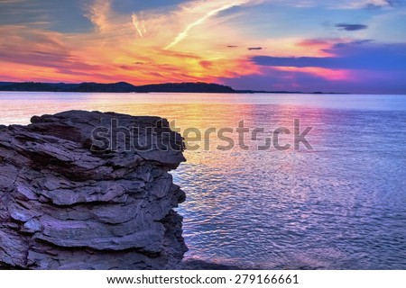 Magical Marquette Michigan Sunset. Sunset along the shores of Presque Isle Park in Marquette, Michigan. This beautiful park is located in the heart of Marquette. The Upper Peninsula's largest city.  - stock photo
