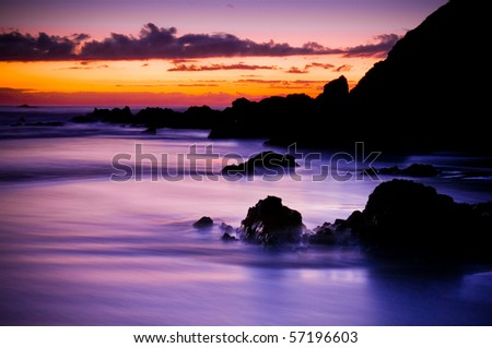 Magical morning coastal sunrise on a beautiful beach. - stock photo