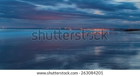 Magical panorama seascape reflection town water. In shades of blue Armacao de Pera. - stock photo