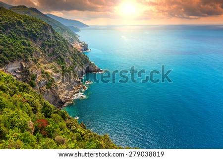 Magical sunset and rocky coast,Cinque Terre National Park,Liguria,Italy,Europe - stock photo