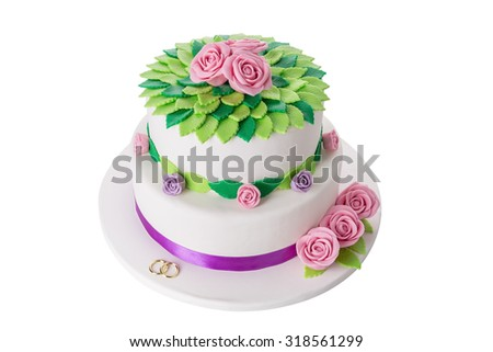 Magical wedding cake for the newlyweds. On a white background close-up. - stock photo