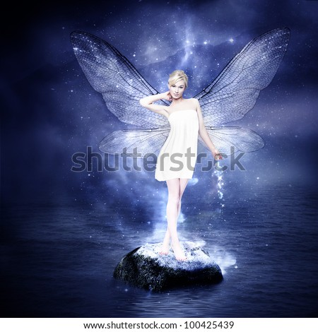 Magical young blond woman as fairy with wings - stock photo