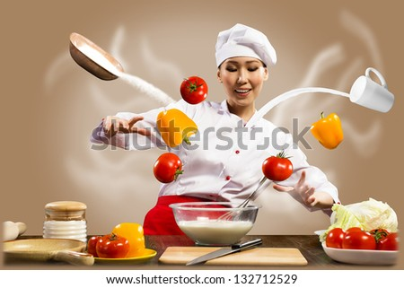 magician chef cook in the kitchen, preparing with magic - stock photo