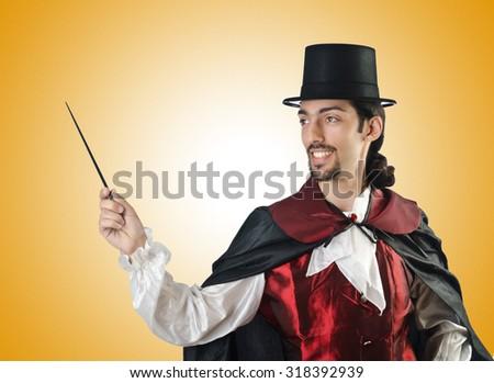 Magician doing tricks on white - stock photo