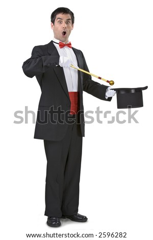 Magician holding a magic wand and a hat - stock photo