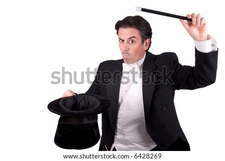 Magician holding a magic wand and a hat isolated over white background - stock photo