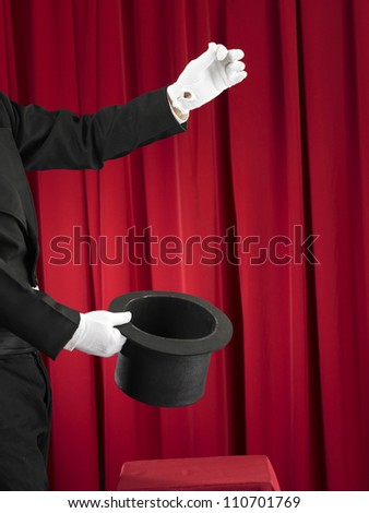 Magician Holding A Top Hat - stock photo