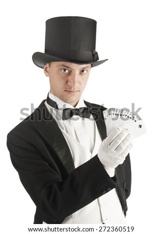 magician holding playing cards, showing focus, juggles - stock photo