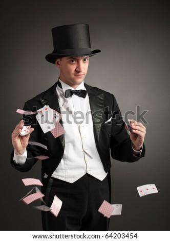 magician juggle cards - stock photo