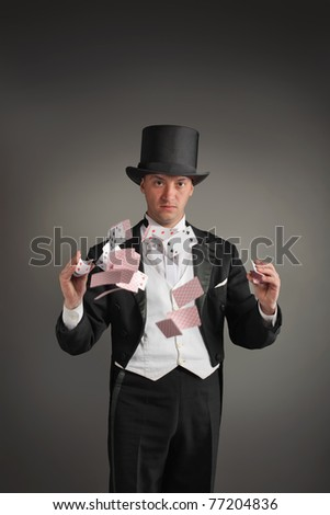 magician make card trick - stock photo