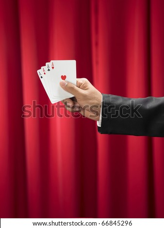 Magician make performance with card deck and top-hat - stock photo
