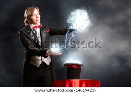 magician makes passes at the cylinder, the cylinder produces magic