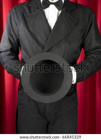 magician offer / showing his empty hat. - stock photo