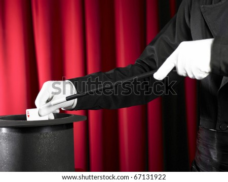 Magician's top hat with magic wand and cards - stock photo