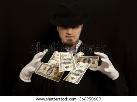 Magician show with dollars banknote. Isolated on black background - stock photo