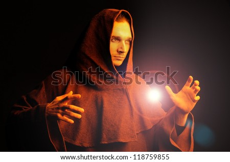 magician with a magic ball in the hands - stock photo