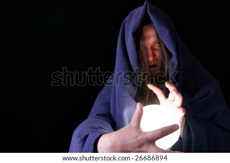 Magician with glowing magical orb close-up - stock photo