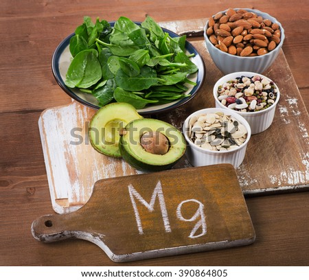 Magnesium Rich Foods on a wooden table. - stock photo