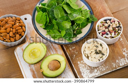 Magnesium Rich Foods on a wooden table. Top view - stock photo