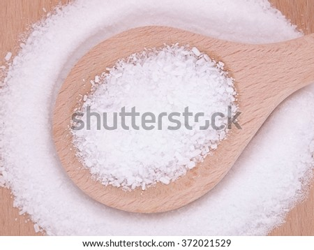 magnesium salt (magnesium sulphate) in wooden spoon  - stock photo