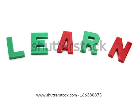 magnet alphabet  LEARN isolated on white background - stock photo