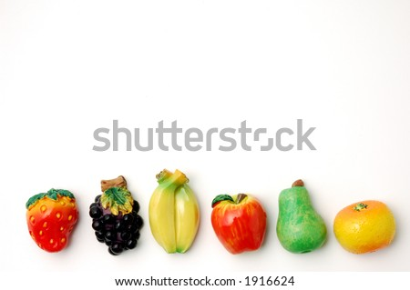 magnet fruit on white background - stock photo