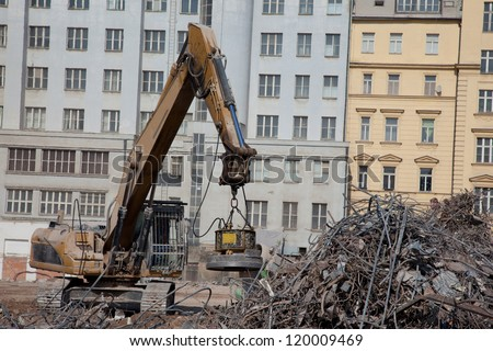 Magnet separate steel at demolition - stock photo