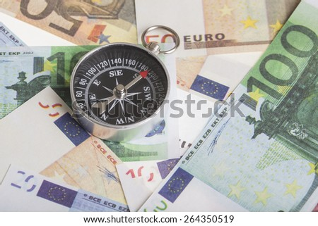 magnetic compass on euro banknotes. financial concept for the trend of the euro exchange rate,  inflation or deflation - stock photo