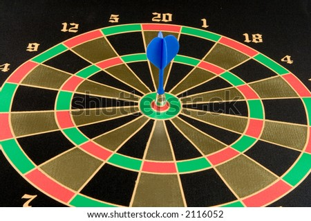 Magnetic dart in a target - stock photo