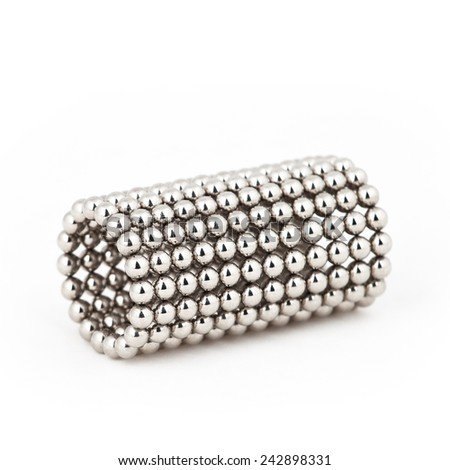 Magnetic metal balls in tube shape  - stock photo