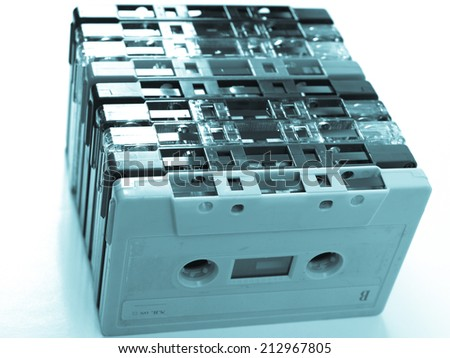 Magnetic tape cassette for audio music recording - cool cyanotype - stock photo