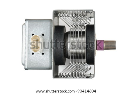 Magnetron from a microwave oven with magnet in its mounting box. - stock photo