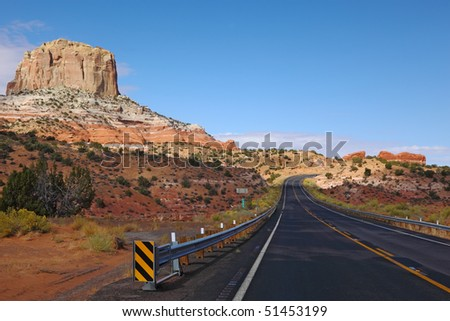 Magnificent American highway in stone desert. State of Utah, early morning - stock photo