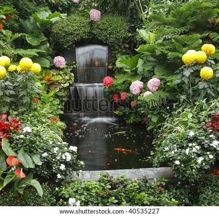 Magnificent cascade fountain and goldenfish in  Butchard-garden on island Vancouver - stock photo