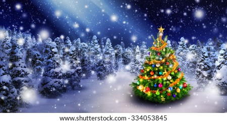Magnificent colorful Christmas tree outdoor in a snowy night with a beam of magical light in the sky, for the perfect Christmas mood - stock photo
